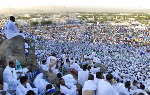 Muslim pilgrims head to pray on a rocky hill called the Mountain of Mercy, on the Plain of Arafat near Mecca, Saudi Arabia, Friday, Nov. 4, 2011. The annual Islamic pilgrimage draws 2.5 million visitors each year, making it the largest yearly gathering of people in the world. (AP Photo/Hassan Ammar)